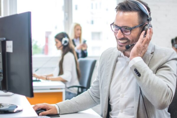 Managed IT service provider answering a client's questions on the phone.